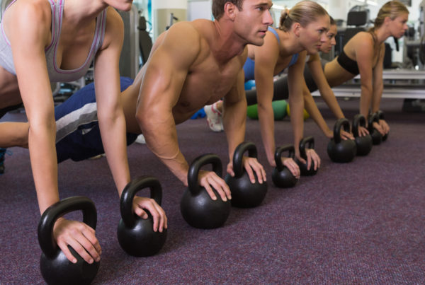 A group of people working out at the gym