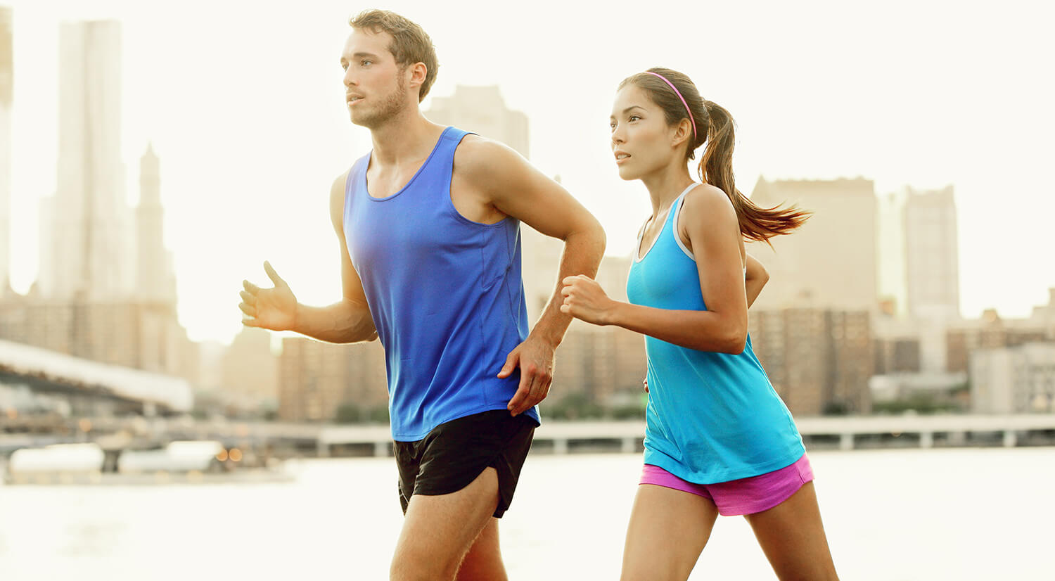 A man and a woman running and exercising