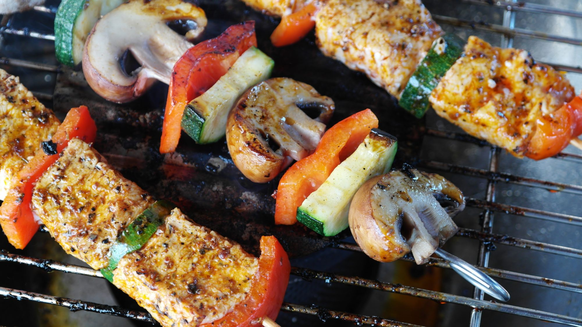 grilled meat, mushrooms, and vegetables