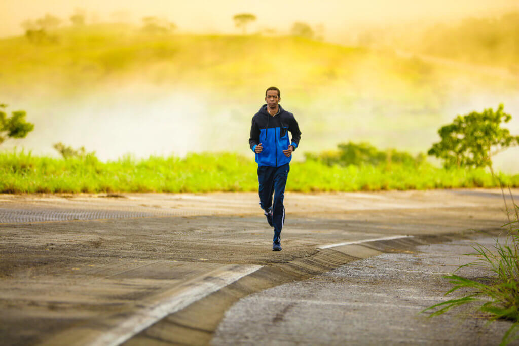 a man running in his sports apparel