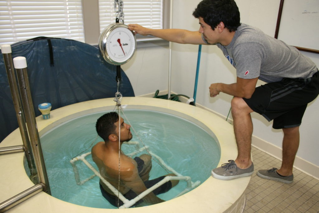 underwater weighing is going on in a tub