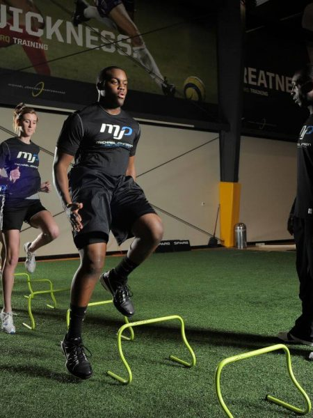 A group of athletes exercising at Michael Johnson Performance